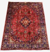Large Persian fine Tabriz red ground carpet, central medallion on busy red field, with stylised fol