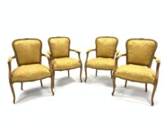 Set four French beech open armchairs, the exposed moulded frame decorated with floral carvings, arm