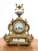 19th century French brass mantel clock with Severus porcelain panels, surmounted by urn finial, eigh