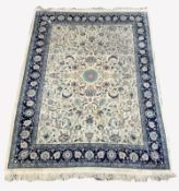 Large Persian design ivory and blue ground carpet, central medallion surrounded by interlaced traili