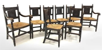 Set eight (6+2) early 20th century dark oak dining chairs, ball finials over floral carved back pan