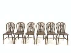 Set six late 19th century beech and ash hoop and spindle back chairs with saddle seats, raised on ri