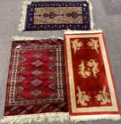 Persian style red ground rug, with repeating gul motif and guarded border, (155cm x 100cm) a Turkish