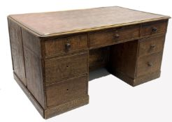 19th century oak estate twin pedestal desk, skivered top over one long drawer and two banks of three
