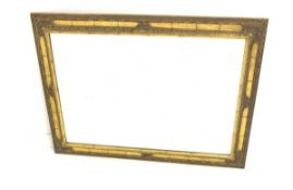 Ornate gilt framed mirror, with shell and floral moulding enclosing bevelled plate, 77cm x 107cm
