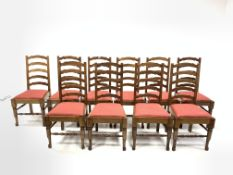 Set of twelve oak waved ladder back dining chairs with drop in upholstered seat pads and turned fron