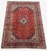 Persian fine Kashan red ground carpet, with floral medallion on red field with interlaced foliate, t