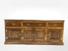 18th century style oak dresser, one long and two short drawers with pierced brass pull handles, over
