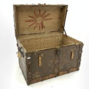Early 20th century American steamer trunk, leather and metal bound, with scraps of old paper labels,