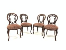 Set of four Victorian mahogany side chairs, with floral and scroll carved open back over upholstered