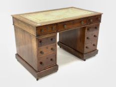 Victorian mahogany twin pedestal desk, the top inset with tooled leather writing surface over three