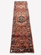Persian Hamadan runner rug, with stylised medallion on red field, 370cm x 103cm