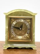 Elliot and Sons onyx cased mantel clock, Silvered dial with Roman chapter ring, retailed by J R Ogde