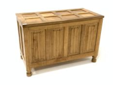 'Eagleman' oak blanket box, with eight panelled hinged lid over four panelled front carved with line