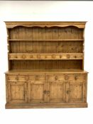 Pine four drawer kitchen dresser, two height plate rack with five spice drawers, four drawers and fo