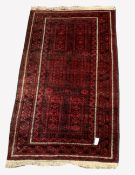 Red afghan rug, with six panels on red field, geometric decoration to border, 204cm x 113cm