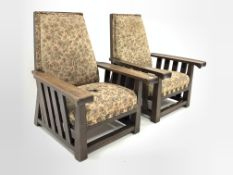 Two large early 20th century oak framed easy chairs, with moulded open arms, slatted sides, upholste