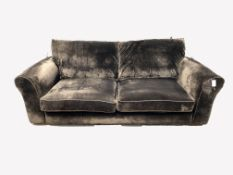 Contemporary three seat sofa, upholstered in brown crushed velvet, with squab cushions, raised on bl