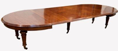 Large Victorian mahogany extending dining table, 'D' ended, with four additional leaves, raised on t
