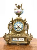 19th century French brass mantel clock with Sevres porcelain panels, surmounted by urn finial, eight