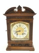 Late 19th century mantle clock in architectural walnut case, arched pediment with central leaf carve