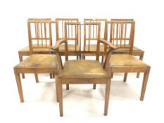 Set of 7 (6+1) 'Acornman' dining chairs, with drop in upholstered seat pads raised on square tapered