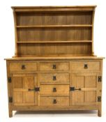 'Acornman' Yorkshire oak dresser, with two height plate rack over five drawers and two panelled cupb