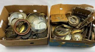 Collection of clock parts to include glass, gongs, dials movements etc, in two boxes and a part tele