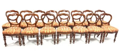 Set 15 Victorian mahogany balloon back dining chairs, with red floral damask covered drop in seat pa