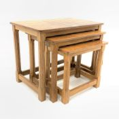 'Mouseman' Yorkshire oak nest of three tables, each with adzed tops, raised on octagonal turned supp