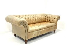 Late 20th century three seat Chesterfield sofa, upholstered in deep buttoned tan leather, raised on