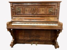 19th century figured walnut Baderbein upright piano, with decorative floral brass sconces, iron fra