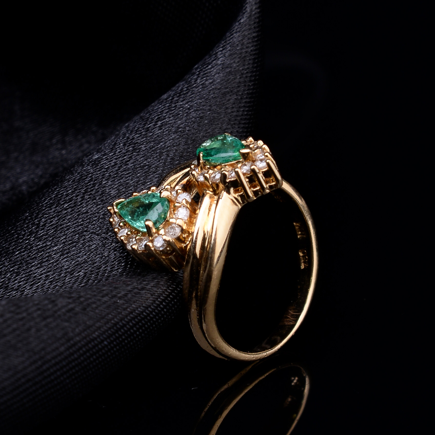 Lot 31 - Vintage Emerald and Diamond 'You & Me' Ring