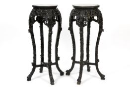 pair of antique Chinese pedestals in finely carved wood and with a marble top - - [...]