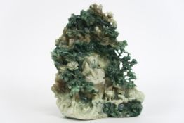 Chinese jade sculpture with a animated landscape with a reading god in a cave - - [...]