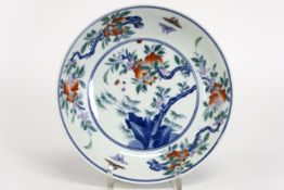 Chinese plate in marked porcelain with a polychrome garden decor - - Chinees [...]