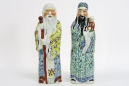 """pair of Chinese """"Sage"""" figures in marked porcelain - - Paar Chinese sculpturen in [...]"""
