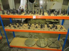Three tier shelving unit c/w approx 75 BT40 toolholders & 3 surface plates etc., as lotted