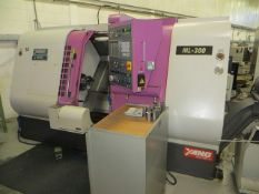 Yang ML-300 CNC lathe with control and Fonge residue discharge conveyor Year: c.2000 c/w two tool