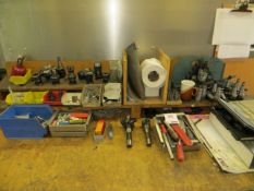 Contents of workbench to include tool holders, cutters & machine clamps as lotted