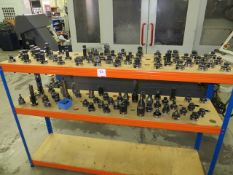 Three tier shelving unit c/w approx 100 BT40 toolholders as lotted