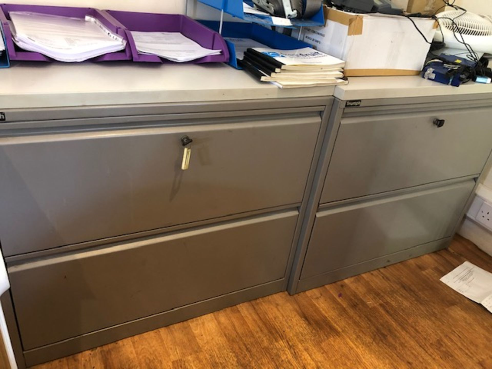 Lot 70 - Three steel two drawer lateral filing cabinets NB This lot to be removed on first day of clearance