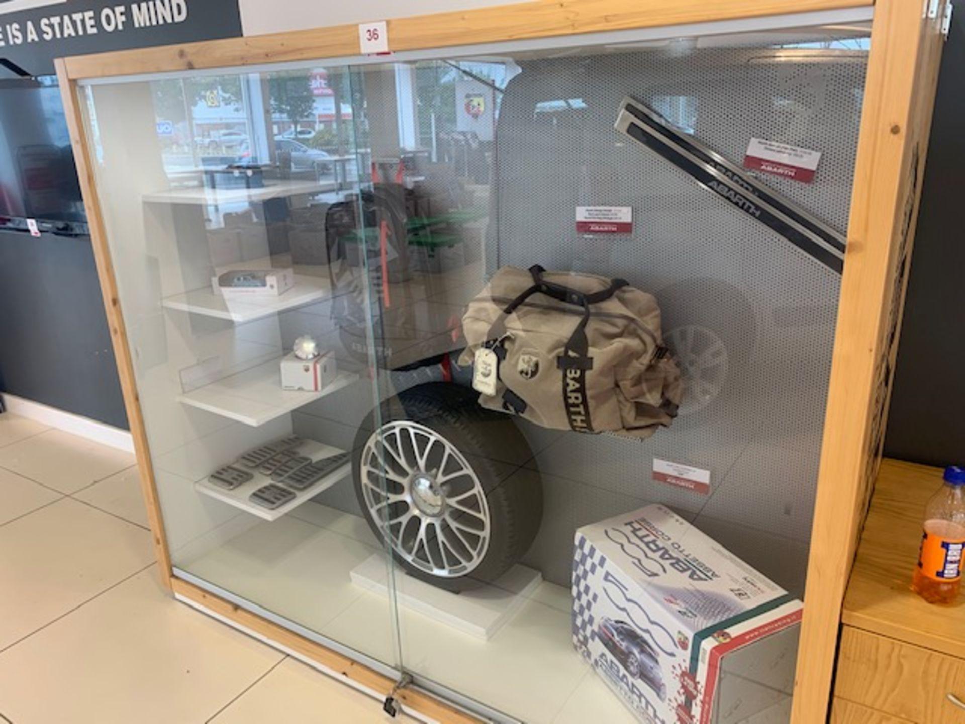 Lot 36 - Fiat Abarth merchandise display unit c/w contents