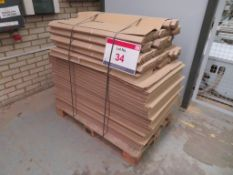 A pallet of cardboard sheets and corner protectors