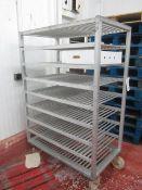 2 x mobile 8 shelf racks, 1200mm x 690mm x 1.8m
