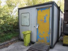 Jackleg portable site office with four windows, single door, approx. size 6.73 x 2.87 x 2.64m,