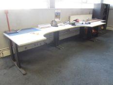 Three grey melamine corner workstations
