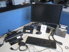Three Dell docking station, three flat screen monitors, keyboard, two mouse