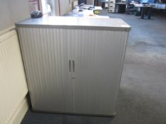 Two tambour fronted half height storage cupboards
