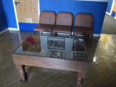 Wood frame glazed top display table, three leatherette meeting chairs
